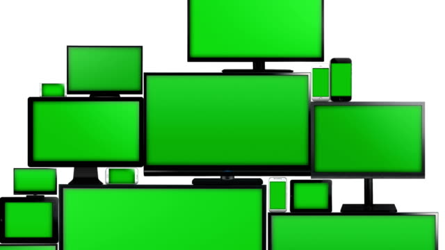 Many different types of screens with green screen Many different types of screens. TVs, computer monitors, smartphones and tablets. They laid on each other in a pile isolated on a white background. They are all with a green screen. Zoom in. group of objects stock videos & royalty-free footage