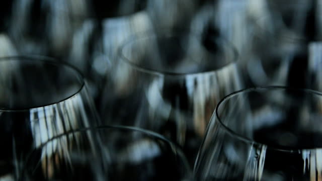 many empty crystal wine glasses stands on table - bicchiere vuoto video stock e b–roll