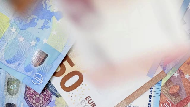 many Euro banknotes flying many flying Euro banknotes of European currency european union currency videos stock videos & royalty-free footage