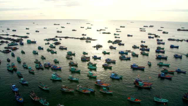 Many fishing boats in the sea near the shore