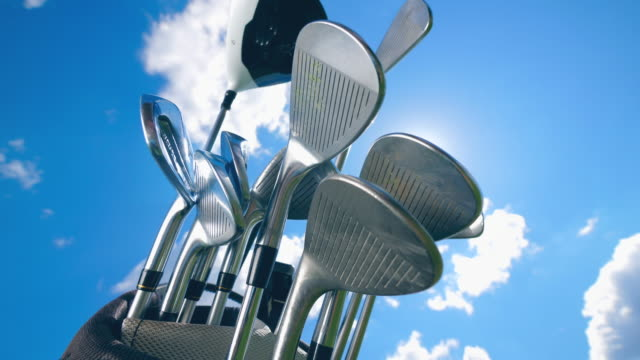 Many golf clubs on a sky background. video