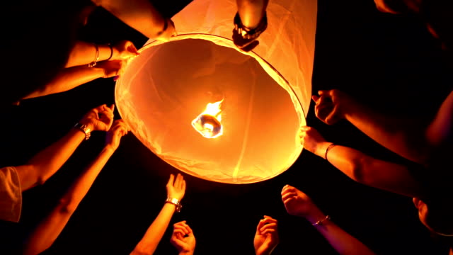 SLO MO Many Hands floating Sky Lantern Loi Krathong and Yi Peng Traditional Festival, Chiang Mai Province, Thailand
