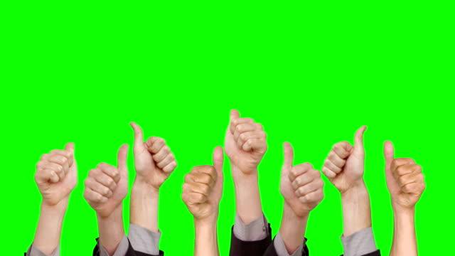 многие руки, показывая большой палец вверх - thumbs up стоковые видео и кадры b-roll