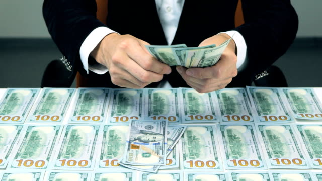 Many hundred us dollars. Successful man with lot of money video