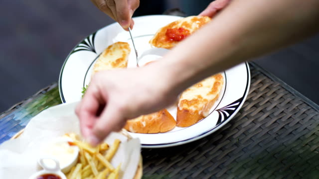 Many Hungry people eating french fries and garlic bread with Salsa Sauce