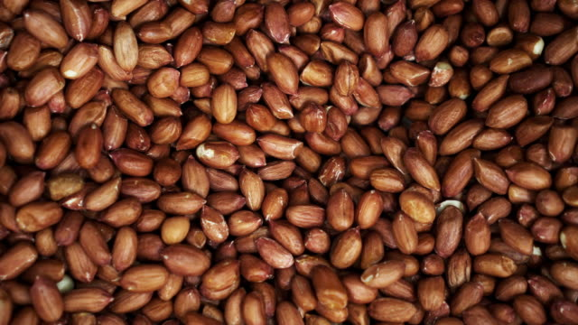Many mixted of red nuts close up rotating on the background in a 4K store