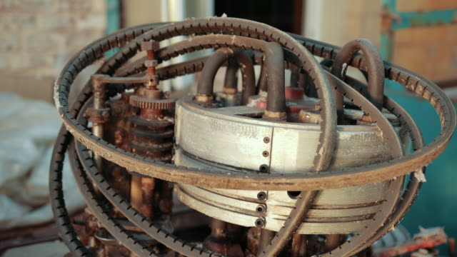 many old scrap from factory, faulty, rusted mechanism, gears.