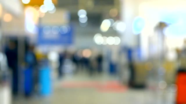 vídeos de stock e filmes b-roll de many people walk inside the mall exhibition store - office background