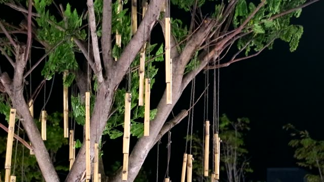 Many pieces of bamboo were decorated on the balcony at night