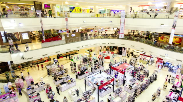 Many poeple in shopping mall,Panning shot video