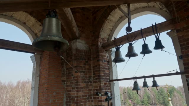 Many ringing church bells in the church bell tower