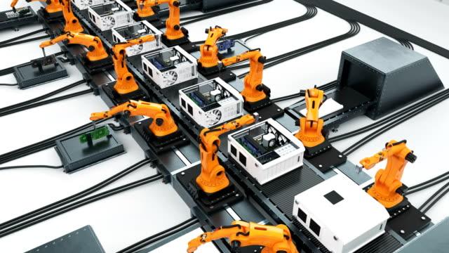 Viele Roboterarme Montage Computer am laufenden Band. Moderne, fortschrittliche automatisierter Prozess. 3d Animation geloopt. Wirtschaft und Technologie-Konzept. – Video