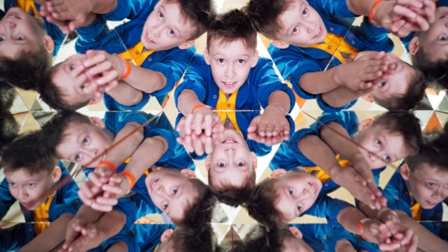 Many small triangles in kaleidoscope and curious boy in each one.