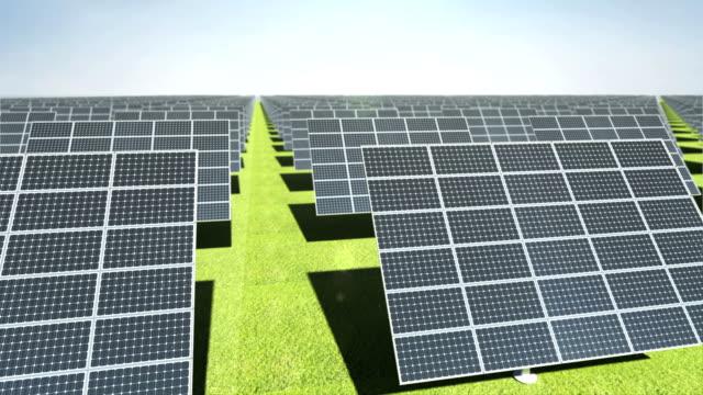 Many Solar panels on green background. eco energy. video