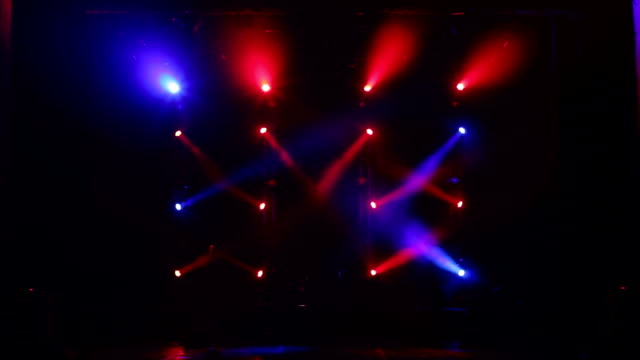 Many spotlights that illuminate the stage at a concert with fog. Stage lights.