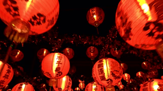 Many swing Chinese lanterns decorated for Chinese New Year at the shrine video