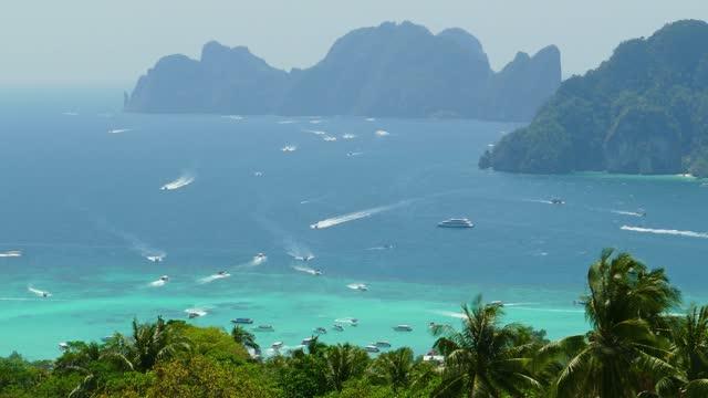 Many tourist yachts near Phi Phi Don island
