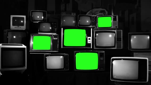 Many Tvs With Green Screens. Black And White Tone. video