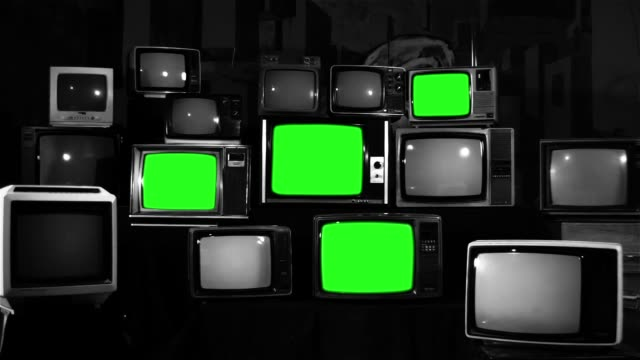 many tvs with green screens. noir tone. aesthetics of the 80s. - television industry stock videos & royalty-free footage