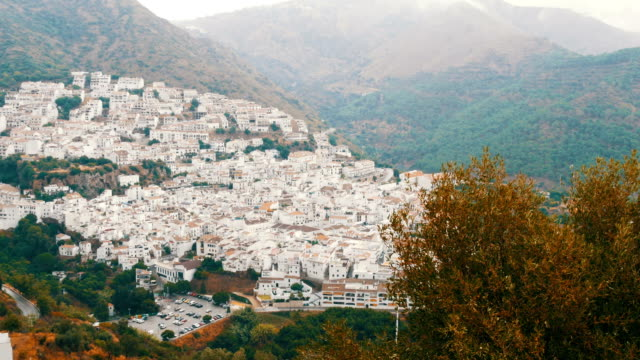 Many white houses are high in the mountains,panoramic view,Stunning beauty of the white villages of Andalusia in Spain. video