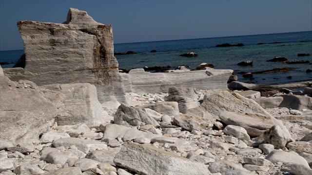 Marble rocks on the beach Marble rocks on the beach in Thasos Island. aegean islands stock videos & royalty-free footage