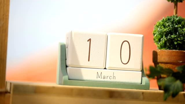 march 10th, wooden calendar on the table. - marzo video stock e b–roll