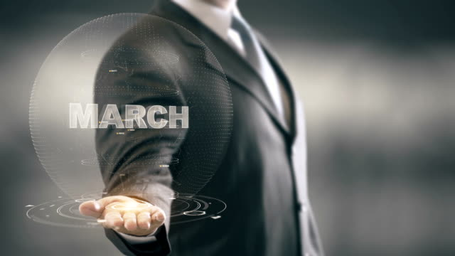 March Businessman Holding in Hand New technologies