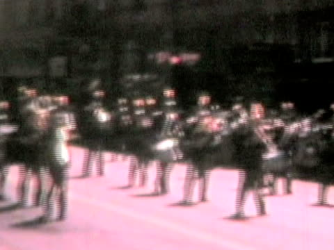 Marching band at parade-From 1950's film video