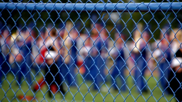 Marching Band Behind Fence video