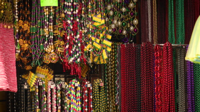 Mardi Gras beads for sale in the French quarter of New Orleans Colorful beads for Mardi Gras on display in the French quarter of New Orleans Louisiana USA mardi gras stock videos & royalty-free footage