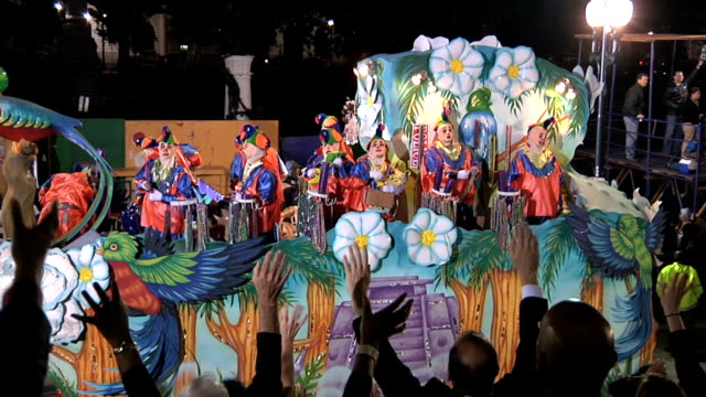 Mardi Gras parade float with masked riders