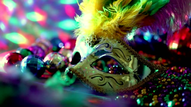 Mardi Gras, Rio carnival mask and colorful beads and feather decorations.