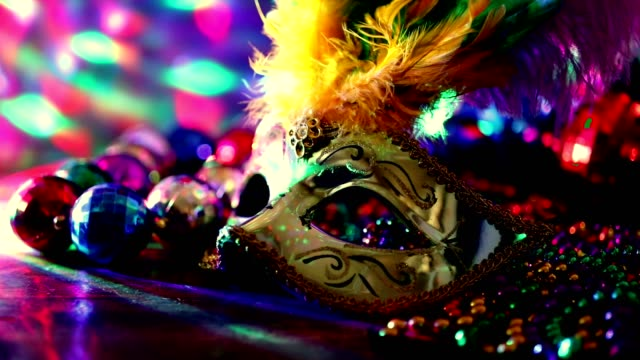 Mardi Gras, Rio carnival mask and colorful beads and feather decorations. video