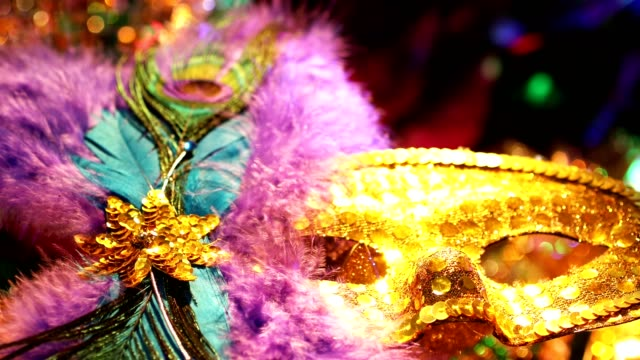 Mardi Gras, Rio Carnival masks with feathers and colorful decorations. Mardi Gras or Rio Carnival masks and colorful carnival decorations.  No people. mardi gras stock videos & royalty-free footage