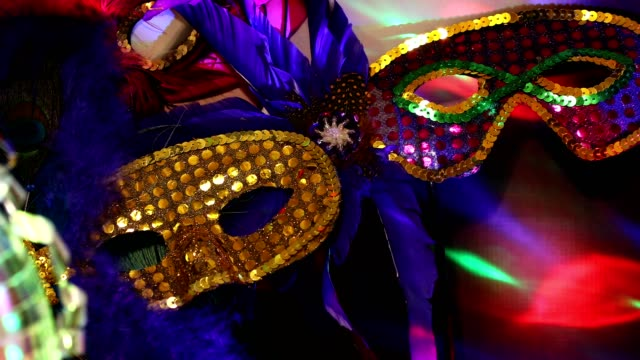 Mardi Gras, Rio Carnival masks with feathers and colorful decorations.