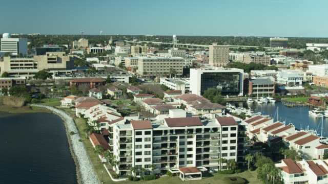 Marina, Apartment Buildings and Downtown of Pensacola, Florida - Aerial video