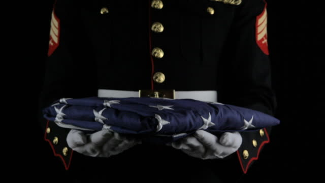 Marine Passing Flag Marine passing American flag. memorial day stock videos & royalty-free footage