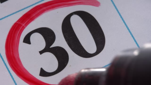 Marking the date in the calendar with a red marker