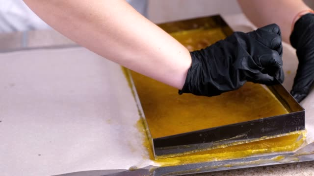 marmalade removed from the mold. production of sweets. - sostanza gelatinosa video stock e b–roll