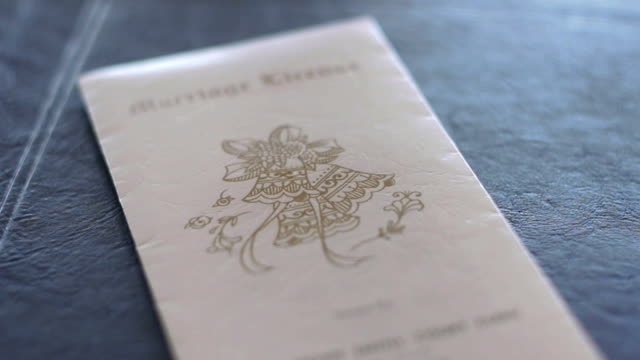 Marriage license on leather album video