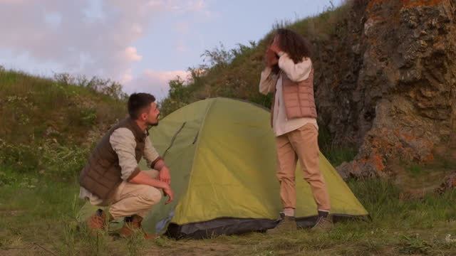 Married Couple Setting Tent