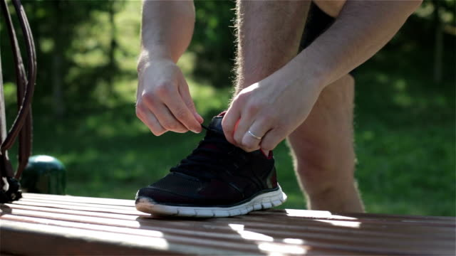 A married man tying shoelaces. video