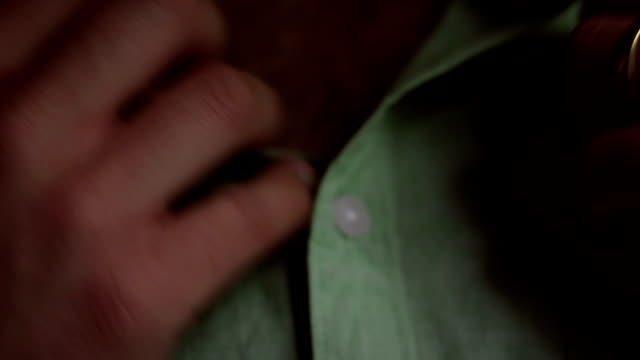 Married man undresses his button up shirt before camera video