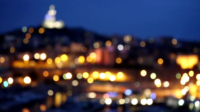Marseille city with old Vieux Port night blur background video