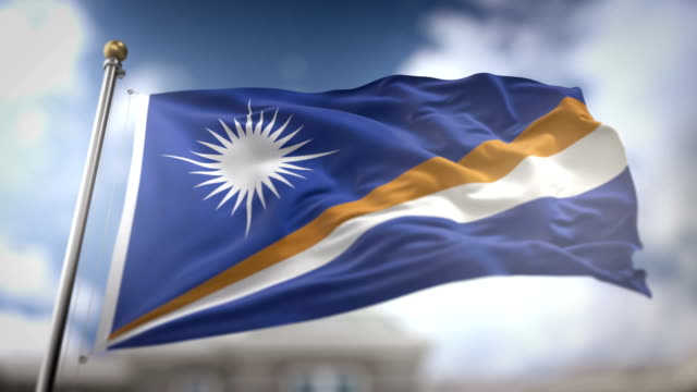 marshall islands flag waving slow motion 3d rendering blue sky background - seamless loop 4k - majuro video stock e b–roll