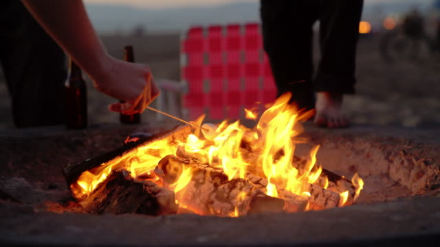 Marshmallows being roasted on a campfire video