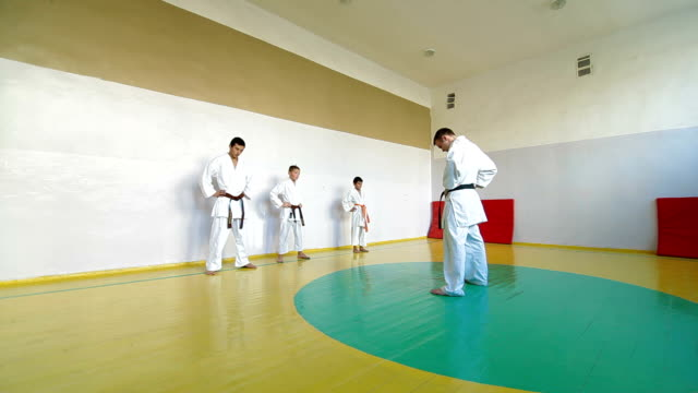 Martial arts instructor training  students Martial arts instructor training  students in gym young singles stock videos & royalty-free footage