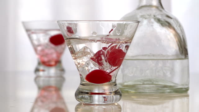 Martini Splash Cherry Slow Motion Cocktail Cherry and Ice  Splash cherry stock videos & royalty-free footage