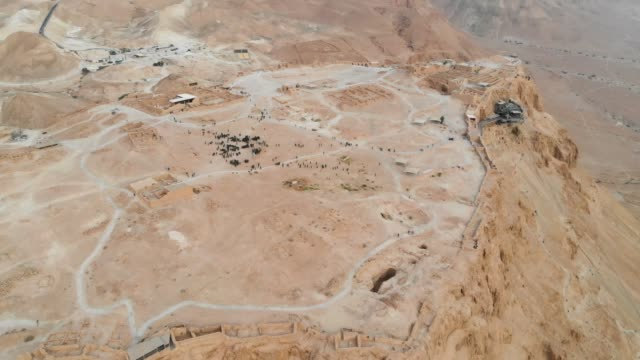 Masada - Aerial footage of the ancient fortification in the Southern District of Israel. Israeli soldiers on top of the mountain. Masada - Aerial footage of the ancient fortification in the Southern District of Israel. Israeli soldiers on top of the mountain. Moving forward. Flying over Masada. The view from the top. 4k national landmark stock videos & royalty-free footage
