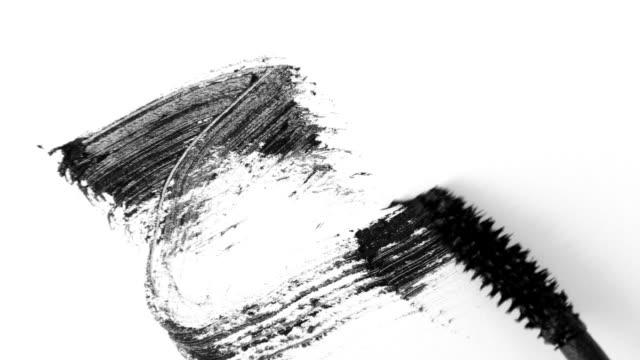 Mascara brush on white. Stroke of black mascara with applicator brush close-up, isolated on white backdrop Mascara brush on white. Stroke of black mascara with applicator brush close-up, isolated on white backdrop. Eyelash Makeup, smudge close up. mascara stock videos & royalty-free footage